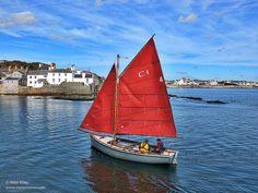 A traditonal boat in full sail, Castletown