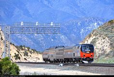 """Southern California's Cajon Pass sees about 100 trains per day, from both BNSF Railway and Union Pacific (plus two Amtrak trains per day as well), and they tend to be long, heavy freights necessitating the need for triple-track (as well as the former Southern Pacific """"Palmdale Cutoff"""" mainline). So this little four-car Amtrak special looks a little lost in this land of giants! The special, heading from Los Angeles to Modesto (and then on to Sacramento the next day), consists of P42DC 156..."""
