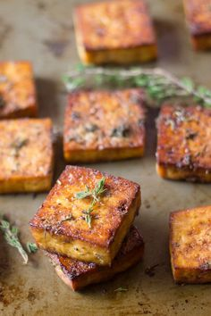 This flavor-packed baked tofu is soaked in a marinade of zesty lemon juice, zippy garlic, and savory herbs, then baked to perfection. It's perfect stuffed in a sandwich or sprinkled on salad! I almos