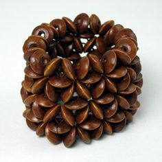 """Hand-crafted wood bead bracelet will make a great addition to your fashion collection. 2"""" long. Elastic stretches to fit most wrists. Buy Here: http://africaimports.com/go.asp?agent=J'aime L'Afrique"""
