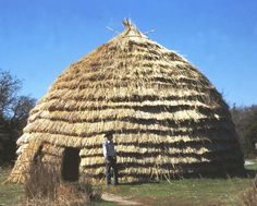 Grass house.Grass houses are American Indian homes used in the Southern Plains by Nations such as the Caddos. They resemble large wigwams but are made with different materials. Grass houses are made with a wooden frame bent into a beehive shape and thatched with long prairie grass. These were large buildings, sometimes more than 40 feet tall.