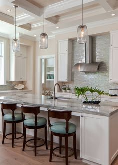 Expand your kitchen backsplash to cover the wall behind your stove as much as your budget permits.What's Your Style?Let's Talk561-866-7084www.tatianafaurer.com