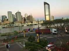 QPAC forecourt, Brisbane River and 1 William St offices, at sunset