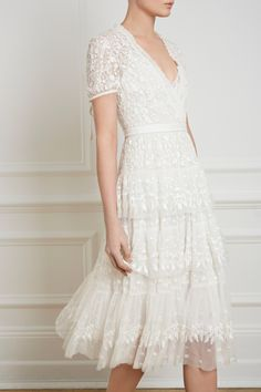 New for Spring/Summer 2018, the Layered Lace dress in ivory takes its inspiration from Victorian styling with a delicately frilled neckline and a tiered skirt. This pretty embroidered ivory dress has an all-over lace-like artwork and the sheer capped sleeves add contemporary romance. The midi length keeps it wearable throughout the season.