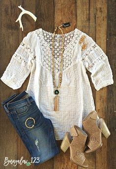 Gorgeous lightweight top in White featuring crochet placket across top and back. Looks great with denim! You will need a layer under this - one of our B123 Seamless Camisoles in White work perfectly.