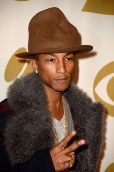 A Timeline of Pharrell's Most Statement-Making Headgear: 2014: The Vivienne Westwood hat made such a splash at the Grammys that he wore it again just two nights later at a Beatles tribute in LA.
