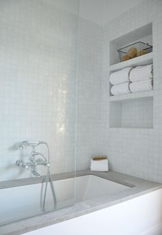 BATH- non-soaker free standing tup. gray quartz surround, white subway tile. tiles + recessed shelf