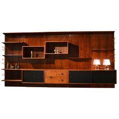 Finn Juhl Brazilian rosewood wall unit   From a unique collection of antique and modern shelves and wall cabinets at https://www.1stdibs.com/furniture/wall-decorations/shelves-wall-cabinets/