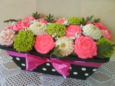 girl BD bouquet - Bouquet for a lady that loves hot pink.  Red velvet, coconut and choc.  with cream cheese icing , 2 dz. reg. size cupcakes.  Silk leaves.  TFL