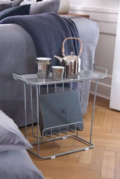 A side table to have next to the couch or bed. Constructed of a frame of metal wire with a loose tray in birch wood from Swedish Åry Form. A versatile table where you can store your magazines and use as a side table or bedside table.
