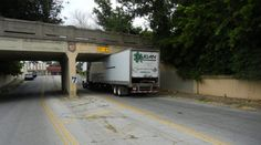 "This particular 13'0"" railroad bridge in Tulsa, Oklahoma really is too low for a 13'6"" truck to go under."