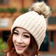 Your head is sure to stay warm and stylish this winter with this classic winter hat, topped with a lovely faux fur pompom. Stylish faux fur pom pom and cozy wool makes for a fashionable and comfortabl