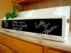 DIY Chalkboard Kitchen Organizer made out of a of a single pallet, paint, chalkboard paint, 3 drawer pulls and 6 curtain rings.