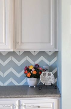 If goldleaf and petrified-wood backsplashes are too rich for your taste, try out these chevron pattern decals from Abby's Vinyl Wall Art on Etsy.