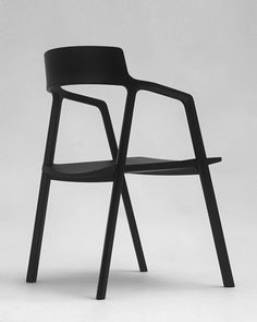 Axel by Alexander Gufler. The idea for this chair sprang from a notion of combining traditional furniture construction with CNC router technology. The Axel chair is made in solid maple. The steam bent seat and backrest are shaped using CNC technology and are then put together with the arms and legs to create the finished chair.