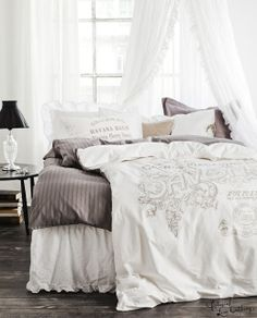 the  curtains and the comforter make the room