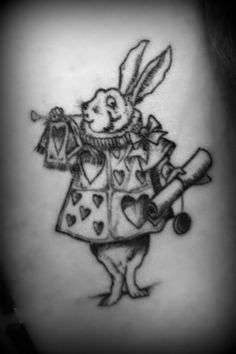 This combines my love of tattoos and Alice in Wonderland! perfection