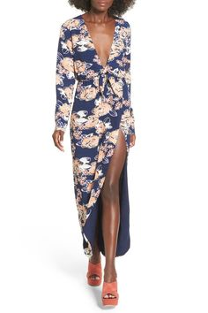 A party-ready wrap maxi dress cut with a plunging neckline and split-front skirt.