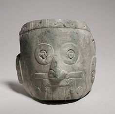Rain God Mask, 13th–14th century. Mexico, Mesoamerica. The Metropolitan Museum of Art, New York. The Michael C. Rockefeller Memorial Collection, Bequest of Nelson A. Rockefeller, 1979 (1979.206.1062) | This mask, carved from a light green serpentine, depicts the rain god Tlaloc with the characteristic ringed eyes, prominent teeth, and a mouth with an upper lip-moustache that curls on each side. He also wears a nose bar in the nasal septum. #mustache #movember