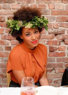 a flower inserted n2 a kinky or curly fro, or a leaf wreath (seen here)