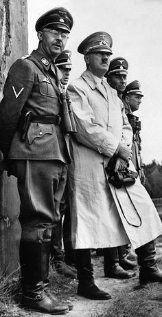 Right-hand henchman: Adolf Hitler stands beside Heinrich Himmler, the head of the Gestapo, to observe a parade of Nazi Stormtroopers in this file photo from 1940