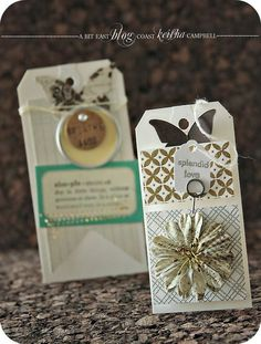 Lovely (as usual) tags from Keisha Campbell. Love the background stamps with metallic embossing.