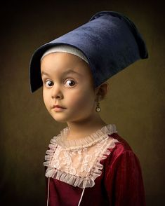 Father photographs his 5-year old daughter in the clothing and settings of Renaissance Dutch, Flemish, and Italian masters