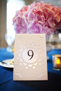 Cute table tent number idea  Photography by vraiphoto.com Floral Design by ashaddflorist.com  Read more - http://www.stylemepretty.com/2012/12/12/chicago-history-museum-wedding-2/