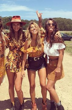 The babe in the middle!!  Sunny yellow crop, studded leather shorts, great belt, and those rad western style ankle booties. Boho festival perfection.