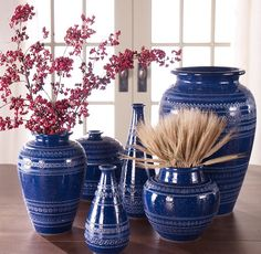 Be a groupie! A royal blue pottery collection makes an impact with seasonal berries and a bouquet of blunt-cut wheat.