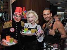 """""""A Six Million Dollar Man's night: Chic celebs turn into waiters for a playful party at Tony's"""" (Photo by Jeff Grass)"""