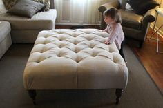 Amazing White Tufted Ottoman Coffee Table With 4 Black Wooden Base Leg And Sweet Brown Single Couch And White Fabric Living Sofas In Modern Living Room With Kid For Inspiring Decor Living Room Ideas Tuffed Ottoman, Leather Ottoman Coffee Table, Large Ottoman, Diy Ottoman, Modern Ottoman, Fabric Ottoman, Ottoman Table, Diy Leather Ottoman, Homemade Ottoman