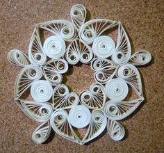 Quilled snowflake...this one looks like angels touching wings!