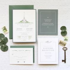 A custom wedding invitation featuring a watercolor portrait of Old Peace Chapel, olive branches and a dusty, gray blue color. | Anticipate Invitations