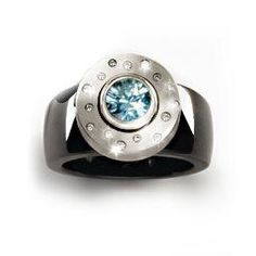 Aquamarine and diamond jewelry pieces with a black ceramic ring base forming an individual ring design.