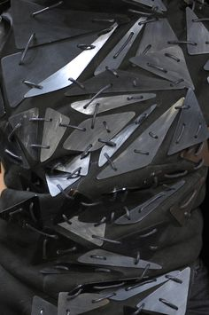 Black dress with geometric embellishments for contrast & texture; close up fashion detail // Rick Owens Fall 2010