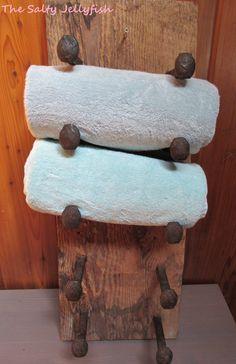 Rustic towel rack, rustic barnwood rack, rustic rack, rustic bathroom decor, country bathroom decor, log cabin decor, railroad spike rack by PerryhillRustics on Etsy https://www.etsy.com/listing/203676322/rustic-towel-rack-rustic-barnwood-rack