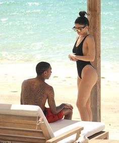 Looking bootyful! Kylie Jenner shows off her curvy figure in a black swimsuit... as Tyga admires the view in Turks and Caicos last week