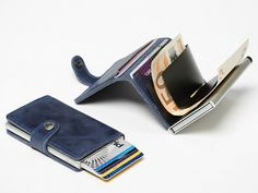 The Secrid Mini Wallet is the slim wallet that stores as much as a fat one. Stores up to 12 cards, cash and even coins. #FathersDay GetdatGadget.com/12-elegant-fathers-day-slim-wallets/