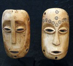 Democratic Republic of Congo | Pair of masks from the Lega people; Ivory. H: 12,7. ca. early 20th century || Price on request