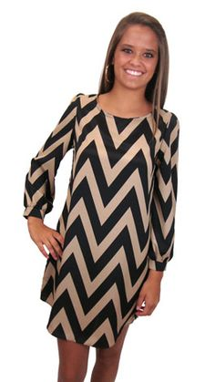 A crowd favorite, BACK in a new chevron print! With bare legs or tights, flats or high heels, you simply can't go wrong with this FABULOUS piece :)  Plus, the black and tan colors are a versatile combo when it comes to shoes and accessories!  Add a bright color if you like, or keep it neutral with simple gold accessories.  It's up to you!    Fits true to size. Avery is wearing size small.