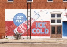 I miss the old painted building advertisements BIG advertisment agaion. showing power, it is a well liked drink,