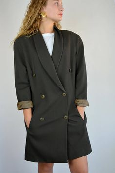 M I C H A E L K O R S vintage jacket! 1990s oversized blazer, can be worn in so many ways! Done in a wool and nylon blend. Deep olive/brown earthy color, perfect for the Autumn season! Double breasted buttons, pockets at front! Fully lined. Small shoulder pads are sewn into interior of lining. A perfect jacket, dress or topper! Size: Small / medium Tag: 12 Brand: -- Excellent Vintage Condition: ♥  Measurements: Bust: 40 Hips: 35 Length: 35.5 Underarm seam: 15.5 Shoulders: 18  Elenas...