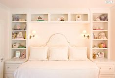 Built in's with sconces. Love the extra storage for a child's room! Ever want to move the bed and it makes for a perfect spot for a desk.