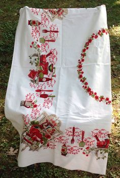 Vintage red and white tablecloth with wonderful images of country kitchen items, coffee grinder, spoons, mortar and pedestal, olive oil by LakesideVintageShop on Etsy