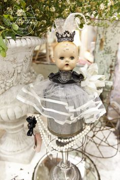 "Awesome altered doll...what I refer to as ""pretty-creepy."" Its creepy but its still pretty!"