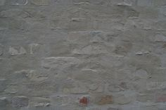 Salvaged bricks pointed with a thin layer of slurry. It reminds me of the masonry by dom. Hans van der Laan. The facade of David Chipperfields Am Kupfergraben gallery in Berlin. Photo by Thom's.