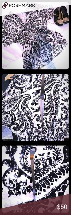 Alice and Olivia 100% silk cold shoulder top! This black and white, cold shoulder, open back, 100% silk top from Alice and Olivia is adorable! It is pre loved but still in great condition. 1 loose string at the outer neckline. I have included a picture. Very minor and not noticeable! The open back is darling and has a cute button at the back. Perfect for a Night out! For styling: Never worn BCBGMAXAZRIA flats and gold choker. Both available in my closet! 💕Bundle and Save💕 Alice + Olivia…