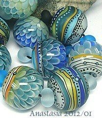 blue, sea foam and gold beads...i want a necklace made of these