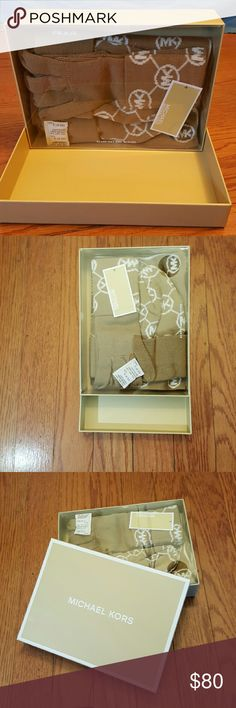 Michael Kors hat/scraf/gloves set(never opened) Brand new MK set! Great idea for a Christmas gift and winter is right around the corner. NEVER been opened out of plastic package. Includes hat scraf and gloves on this set. MICHAEL Michael Kors Accessories